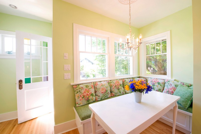 traditional dining room bright colour schemes door ceiling lamp bench pillows table windows chandelier light green white brown