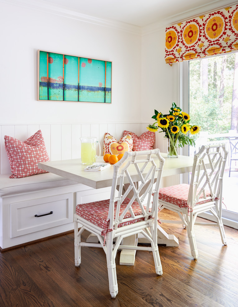 traditional dining room bright colour schemes painting bench pillows hardwood floor chairs table flowers red white blue yellow