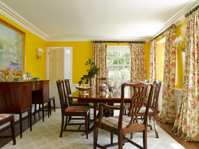 traditional dining room bright colour schemes painting chairs table storage item window curtains wall lamps carpet hardwood floor