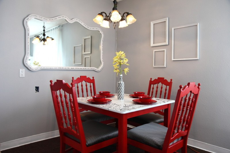traditional dining room bright colour schemes red chairs table gray walls hardwood floor mirror