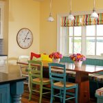 traditional dining room bright colour schemes wood floor chairs green blue window table pillows red yellow traditional style flowers bench hanging lamps