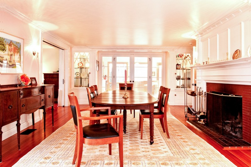traditional dining room colour schemes carpet hardwood floor cabinet painting fireplace chairs table lamps