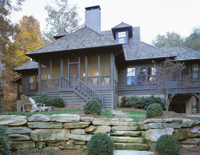 traditional exterior with dark grey skirting made of wood exterior glass windows