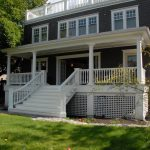 traditional front porch with white lattice white railing system and white stairs