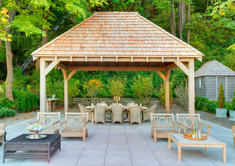 traditional gazebo with wooden poles, vaulted ceiling