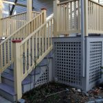 traditional porch with white cedar railing system & exterior stairs grey lattice skirting idea