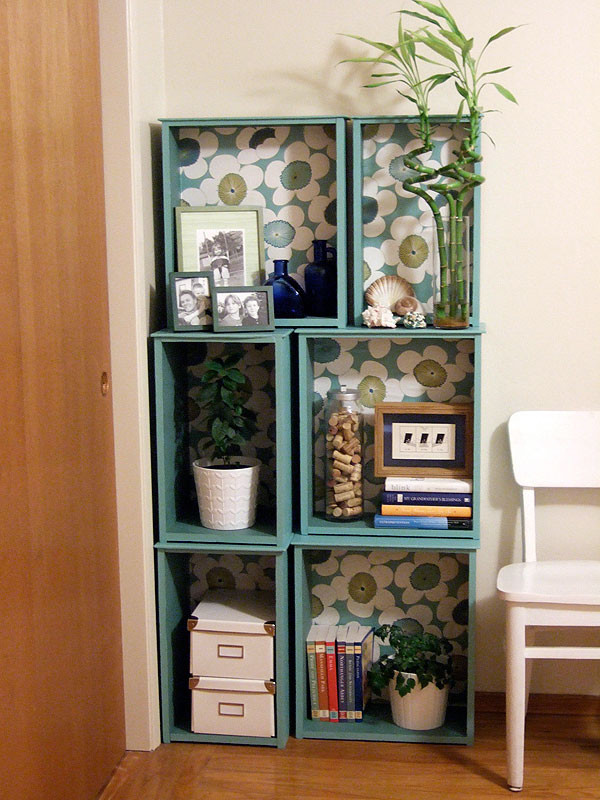 turquoise modular bookcase with flower background small chair in white wood floors light beige walls