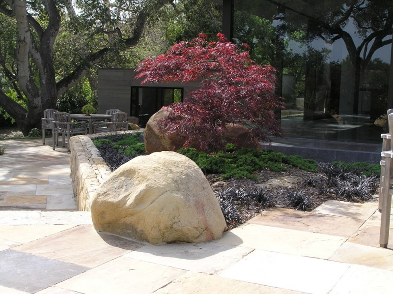two single boulders on the stone flooring