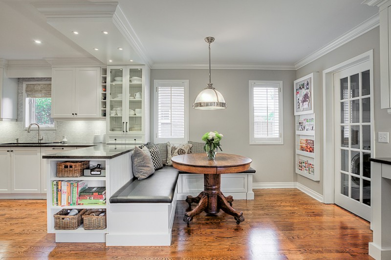 undermount sink recessed panel cabinets white appliances medium tone hardwood floors small magazines cupboard hanging lamp grey wall white ceiling
