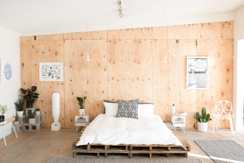 unique wood bed in loft model plywood wall idea lower white bedside table in modern vintage style unique white chair grey mats modern concrete logs for putting the decorative plants