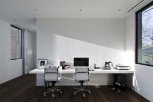 wall computer table wood floor big window chairs ceiling lamps door modern home office design