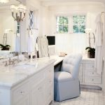 White Countertop Vanity With Under Mount Sink, Large Mirror, Sconces, Makeup Area, Makeup Mirror, Grey Chair,