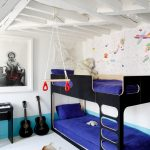 White Painted Walls Acccented By Blue Line At Base Black Bunk Bed With Ladder And Navy Blue Mattress Black Music Instruments Cowhide Area Rug