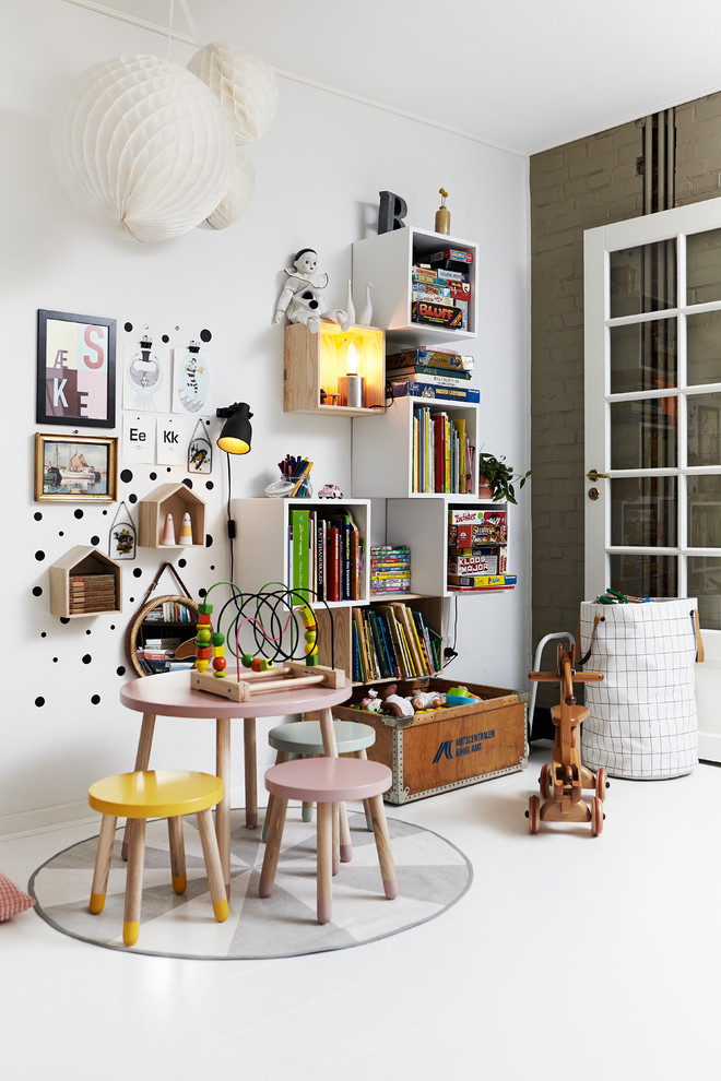 white painted walls with centered stuffs like white floating book shelves small table and chairs in colorful tones and decorative lanterns in white