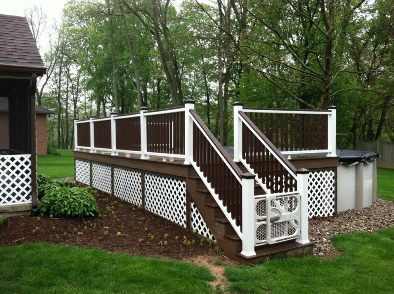 white painted walnut skirt idea with dark wood accent white and dark wood railing system for pool