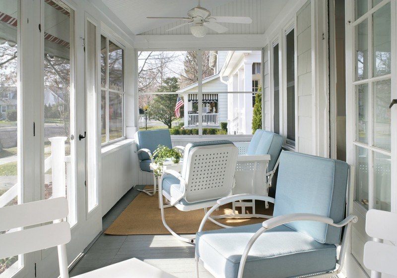 white porch with window, blue wooden flooring, white ceiling, ceiling fan, white wooden chairs with blue cushion