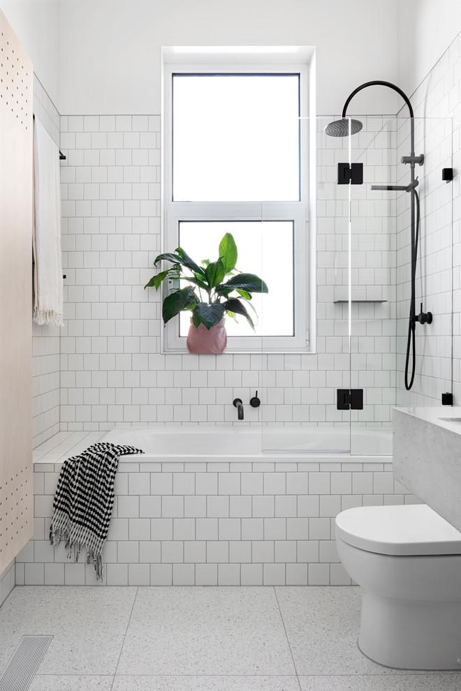 white subway tiles bathtub with black metal shower