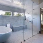 Whte Large Bowl Tub In One Area With The Shower
