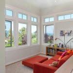 window design for small house windows sofa bookshelves books pillow painting contemporary room