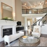 wood flooring ideas for living room carpet table chairs fireplace mirror stairs railing wall lamp ceiling lamp