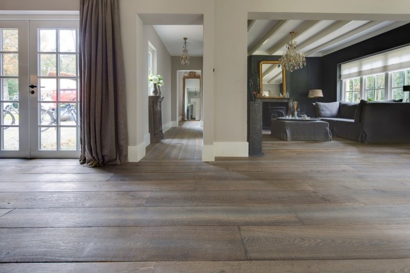 wood flooring ideas for living room doors sofa pillows fireplace mirror windows eclectic room table chandelier