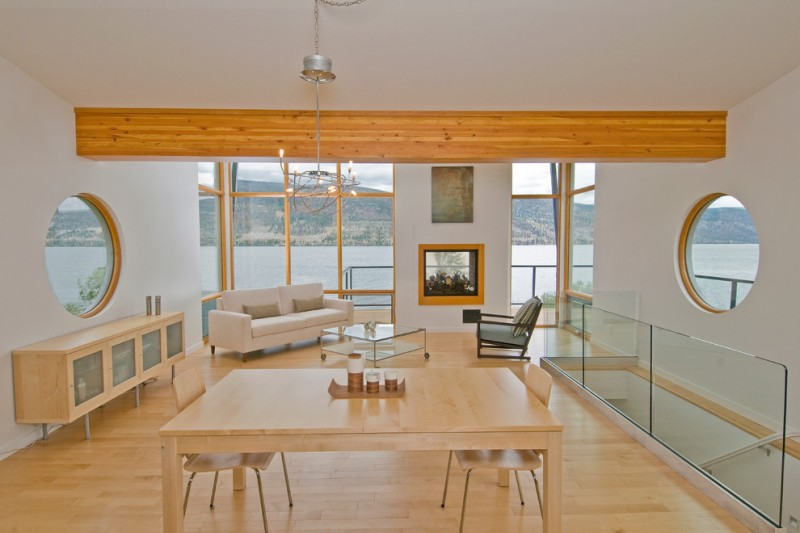wood flooring ideas for living room glass top table chairs sofa hanging lamps pillows windows fireplace