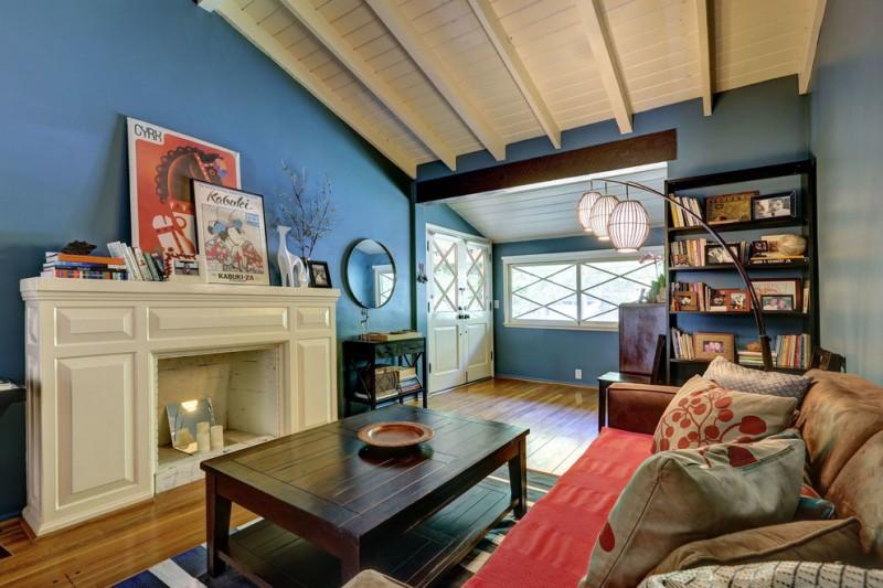 wood flooring ideas for living room table sofa pillows windows carpet bookshelves books mirror