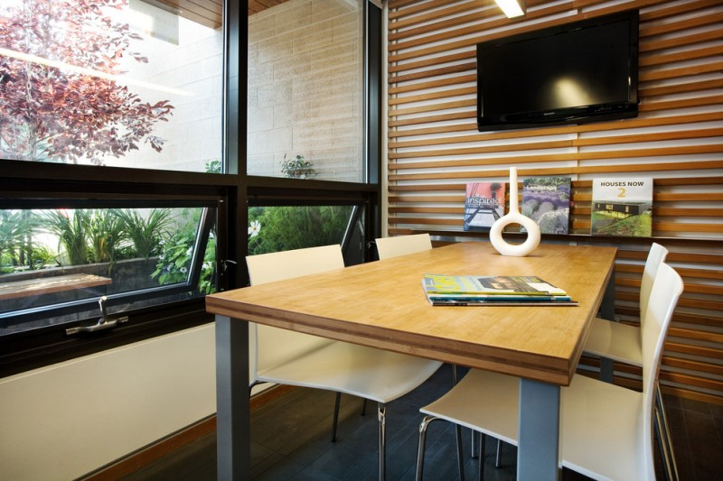 wood rails on one side of the walls of a home office