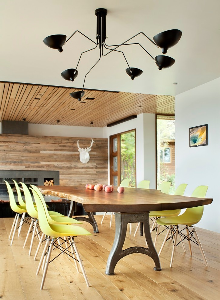 wood top dining table with hard metal base bright yellow dining chairs with walnut base light toned wood floors