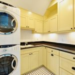 Yellow Letter L Style Cabinets For Modern Laundry Room