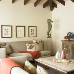 Beach Style Family Room With Beige Walls Nautical Wooden Framed Wall Arts Nautical Accent Pillow Throws Coffee Table Rustic Tv Cabinet Cream Sofa