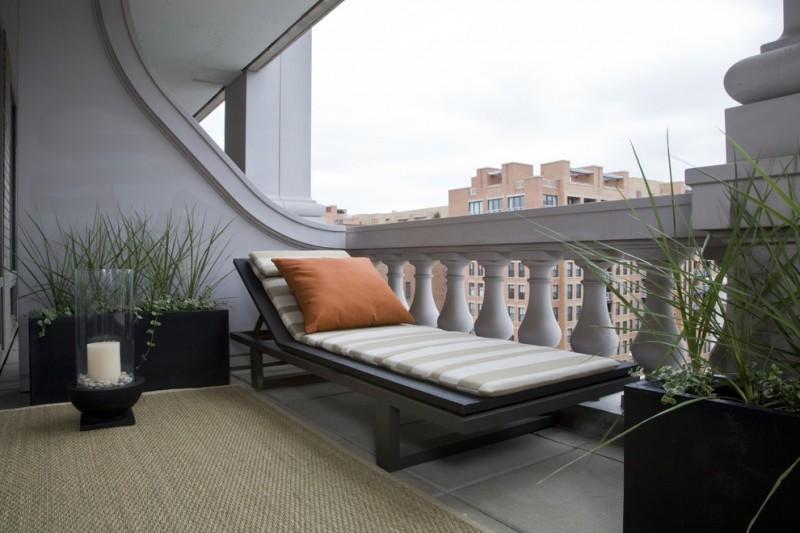 apartment balcony furniture chaise longue carpet decorative plants pillow contemporary area