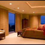 asian inspired bedding bed pillows bedside table ceiling lights cupboard elegant bedroom