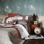 asian inspired bedding pillows wood floor globe bedside table prints tropical bedroom