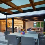 backyard patio covers long tables low back chairs corner sofa bar stools kitchen island kitchenette modern pendants built in cabinets hanging shelves concrete slab contemporary design