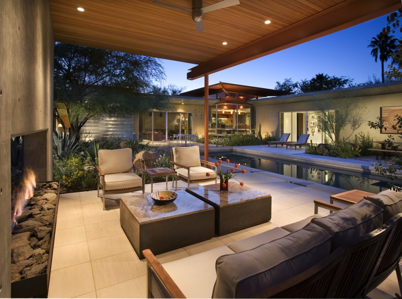 backyard patio covers square ottomans round table chairs sofa ceramic tiles standard fireplace ceiling fan lights pool house modern design