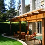 Backyard Patio Covers Upholstered Chairs Round Tables Tennis Table Stone Pavers Beige Walls Contemporary Design