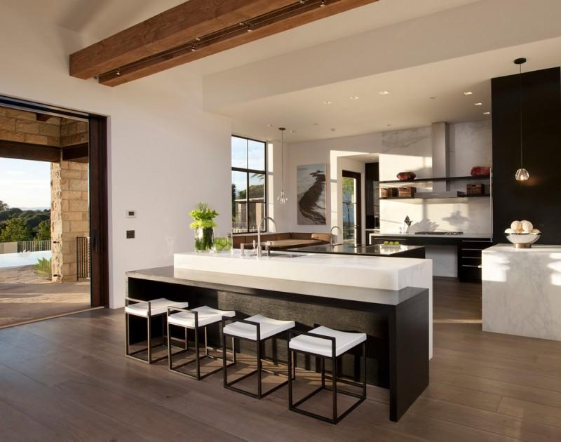 bar style kitchen table open cabinets stools undermount sink pendants ceiling lights hardwood floors white backsplash multiple islands stove contemporary design