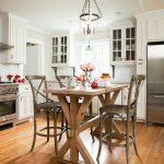 bar style kitchen table wood stools glass pendants countertops kitchenette fridge hardwood floors beach style
