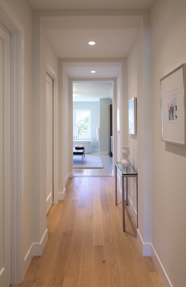 baseboard trim style brown floor small table window contemporary hall