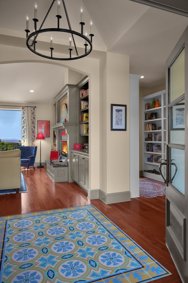baseboard trim style carpet brown floor chair curtain shelves books ceiling lights chandelier traditional entry