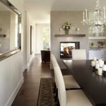baseboard trim style table chairs lamps mirror flowers chandelier carpet fireplace shelf cabinets traditional dining room