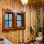 baseboard trim style window wooden wall basket toilet towel rack ceiling ligts lamp rustic bathroom
