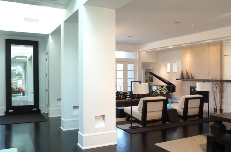 baseboard trim style dark floor ceiling lights piano sofa pillows carpet long shelf contemporary living room