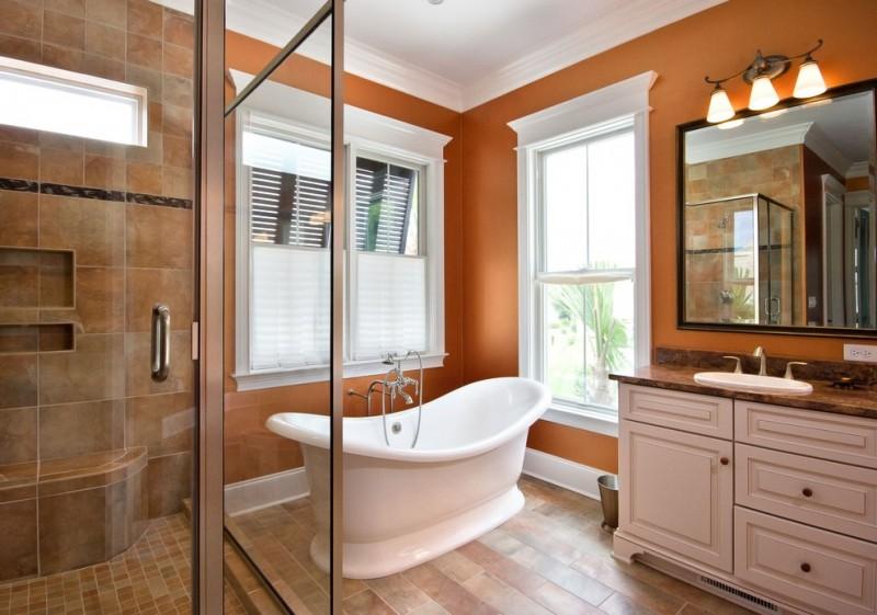 bathroom color trends freestanding tub recessed panel cabiets granite countertop single hole sink mirror hanging modern lamps mirror light wood floor glass door traditional design
