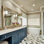 bathroom color trends linoleum floor two piece toilet recessed panel cabinets freestanding tub chair shower window sink mirror hanging lamps transitional design