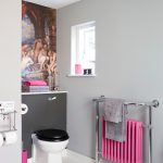 bathroom color trends toilet metallic accessories pink towels standing rack floating shelf wall decoration ceiling light basket transitional design