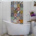 bathroom color trends vessel sink wood countertops freestanding tub multicolored tiles stone floor faucets mirror shower mediterranean design