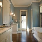 Bathroom Color Trends White Vanities Marble Countertop Double Sink Round Mirrors Faucets Tub Shower Doors Windows Curtain Hardwood Floor Traditional Design