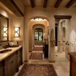Bathroom Color Trends Wooden Vanities Cabinet Marble Countertop Single Sink Faucet Hanging Towel Rack Wall Lamps Plant Decoration Mirror Mediterranean Design